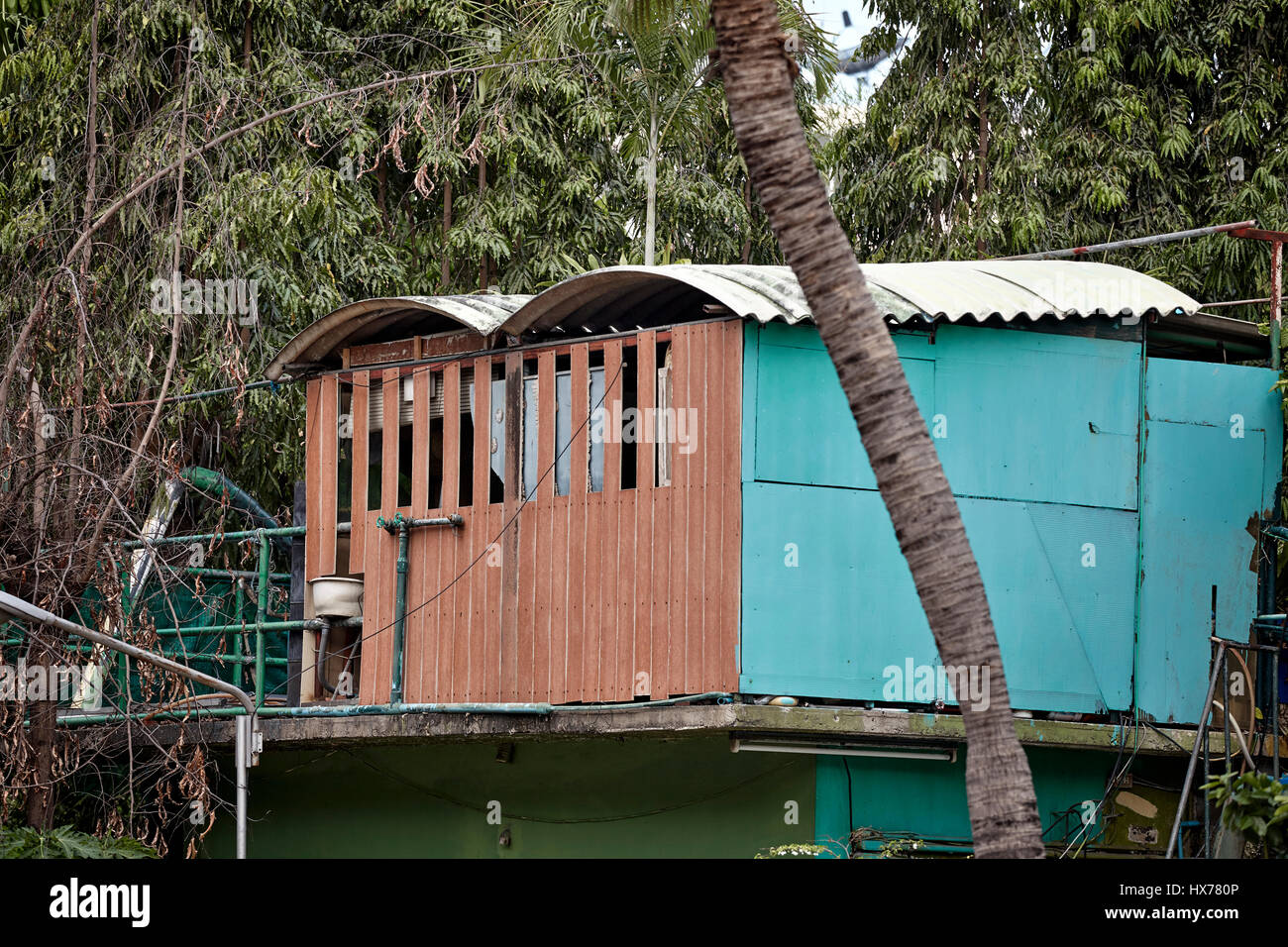 Thailand rural home with unusual WC placement. Southeast Asia - Stock Image