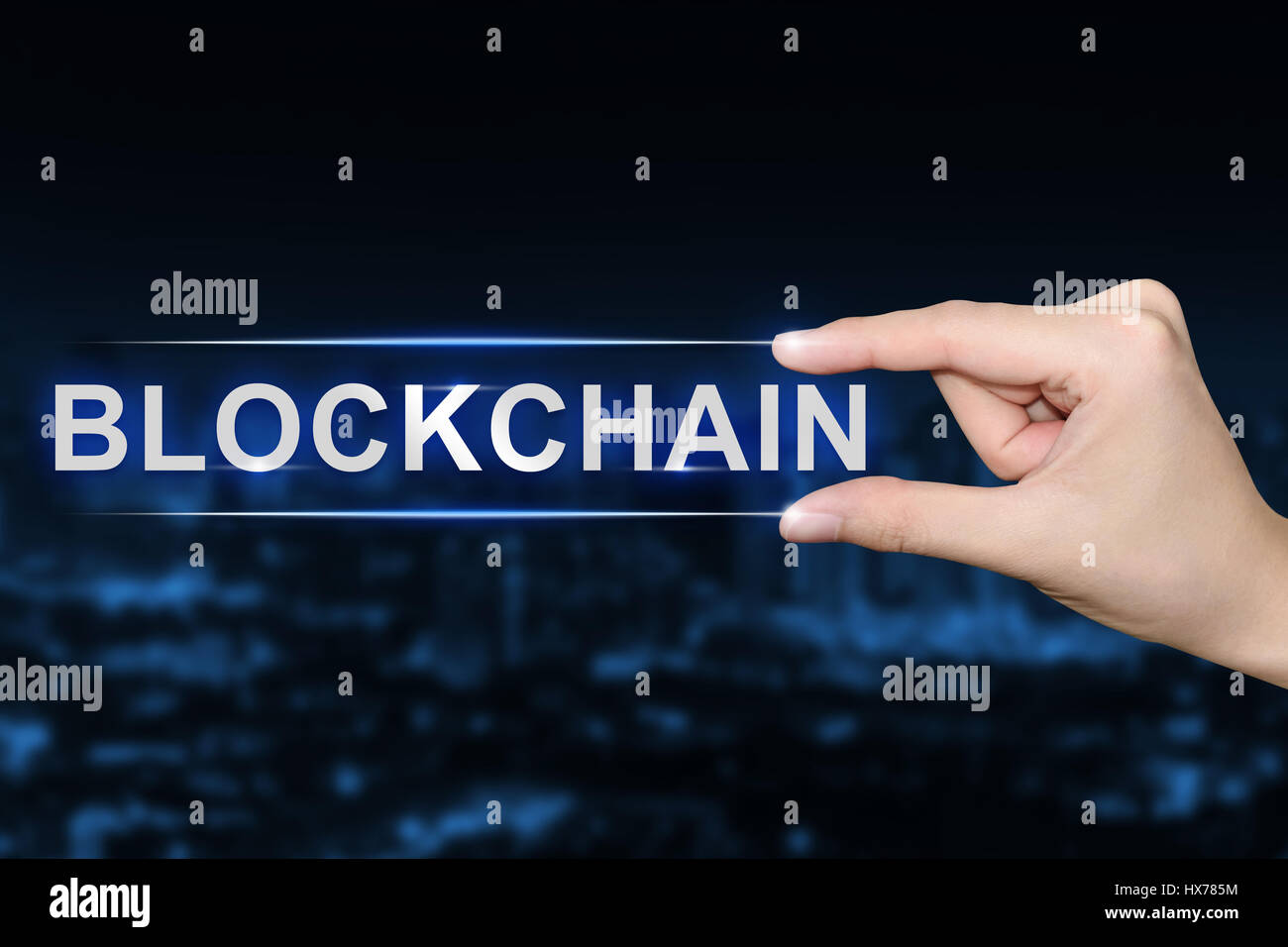 hand pushing blockchain button on blurred blue background - Stock Image
