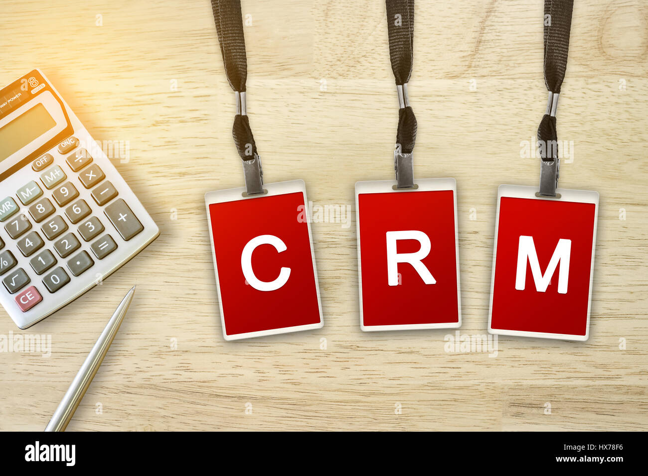 CRM or Customer Relationship Management word on red badge with soft light vintage effect - Stock Image