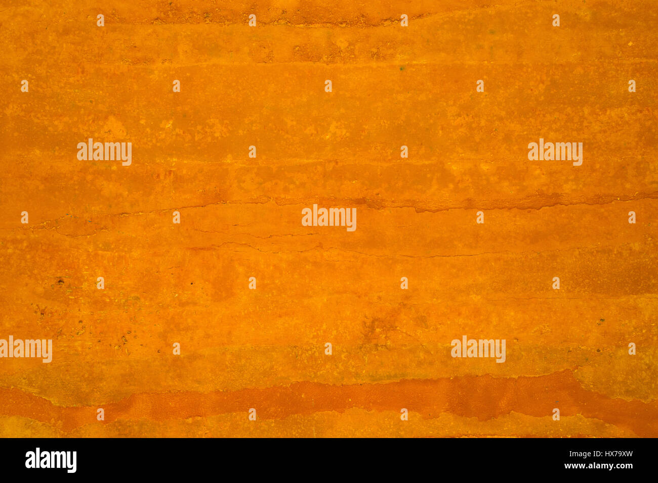 Grungy vintage orange polished concrete background texture Stock Photo