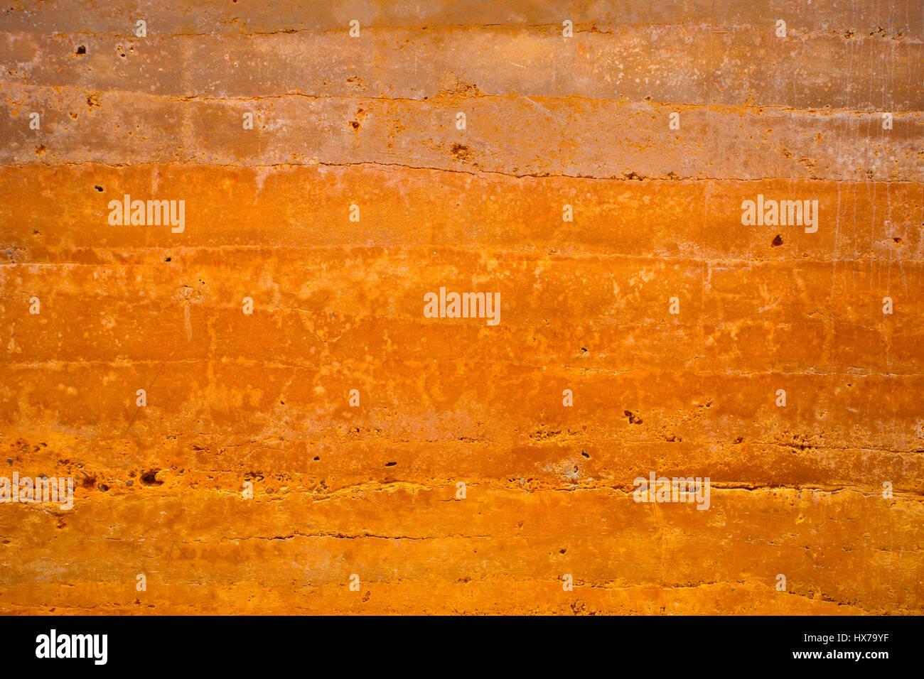 Grungy vintage orange polished concrete background texture - Stock Image