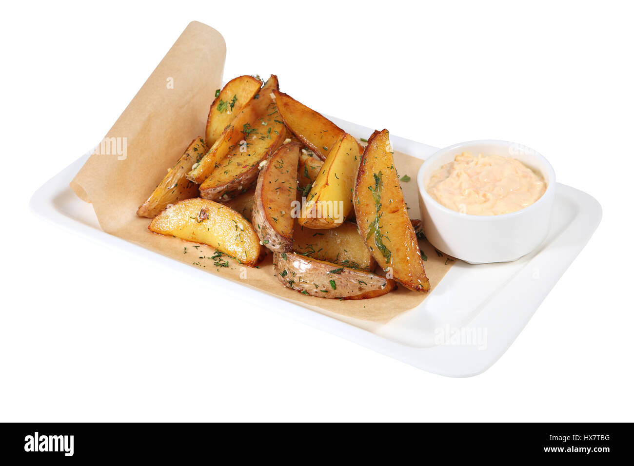 Idaho Fried potato wedges isolated with clipping path. - Stock Image