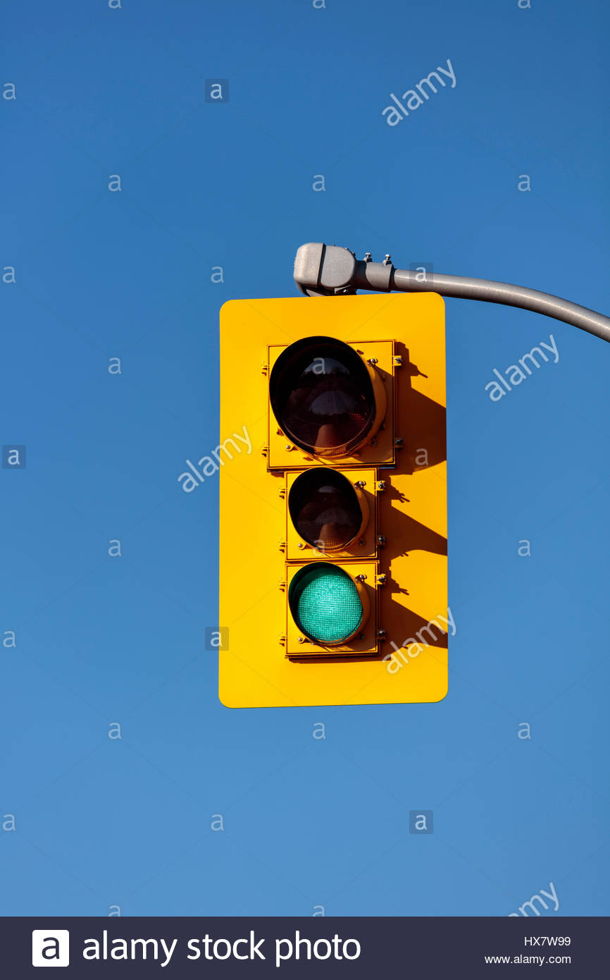 traffic lights, traffic signals, traffic lamps, signal lights, traffic control signals showing green, the signal - Stock Image