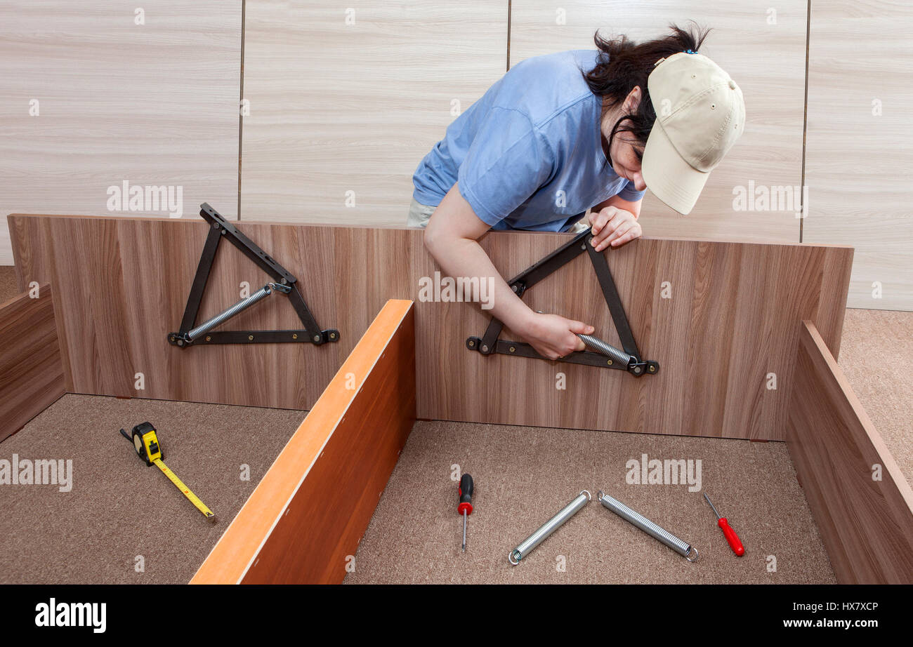 Self assembling furniture at home, Women putting together self Stock ...