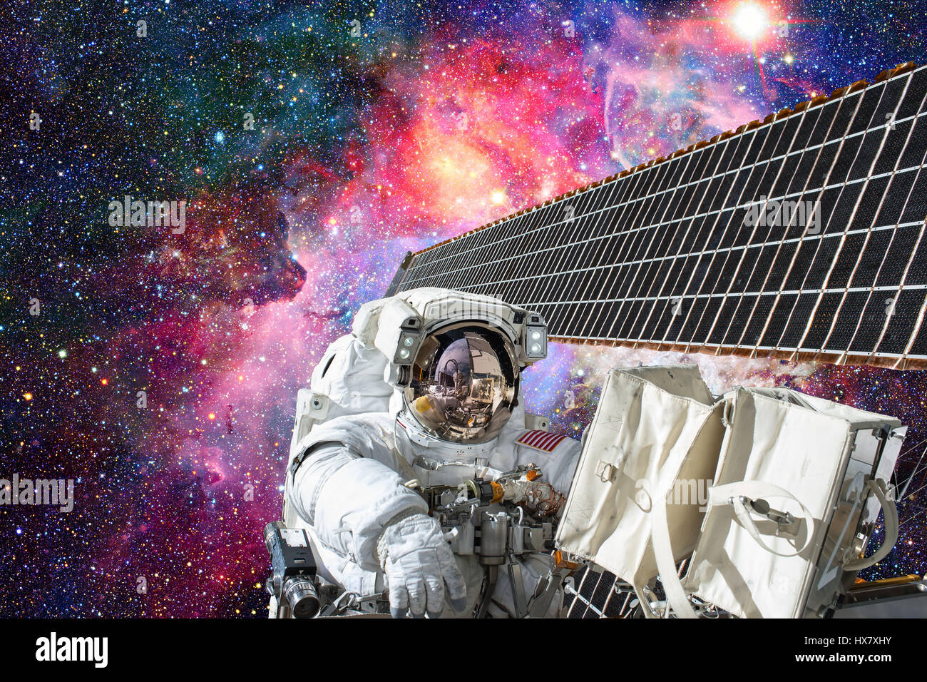 Cosmonaut works outside the International Space Station - Stock Image
