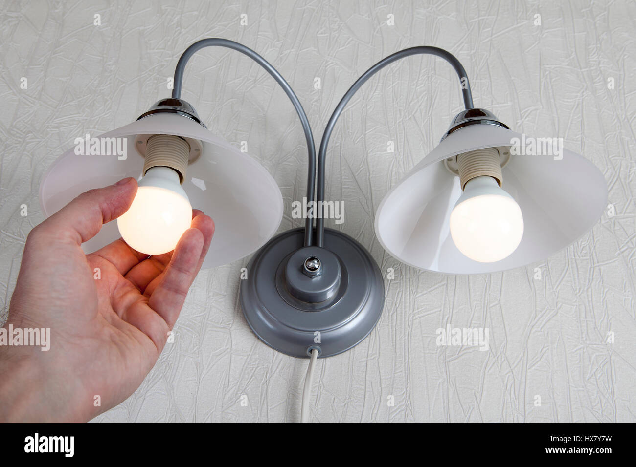 Make The Switch To Energy-Efficient LED lamp, Hand Replacing ...