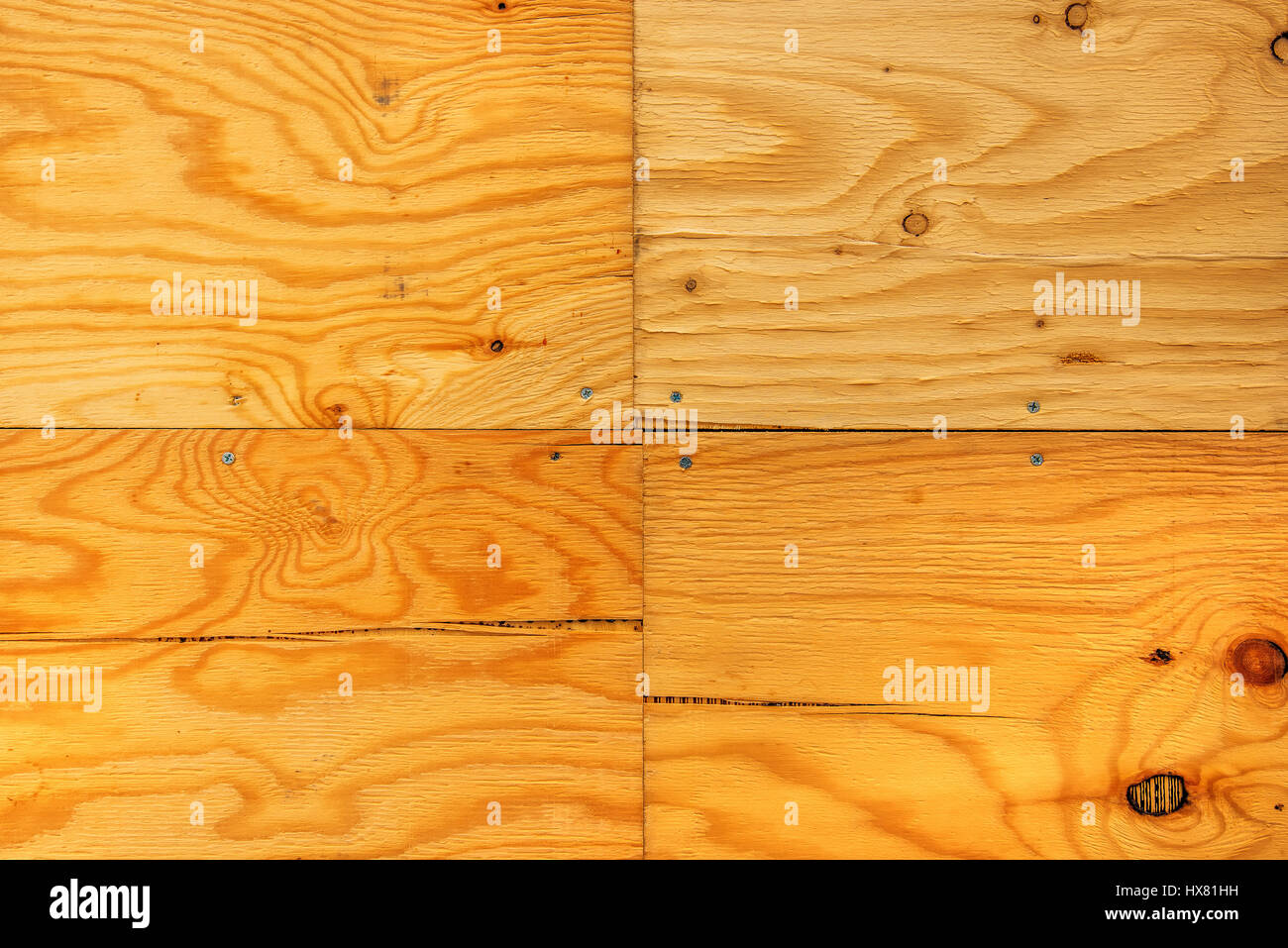 Wooden planks background, four hardwood boards tiled and nailed with screws - Stock Image
