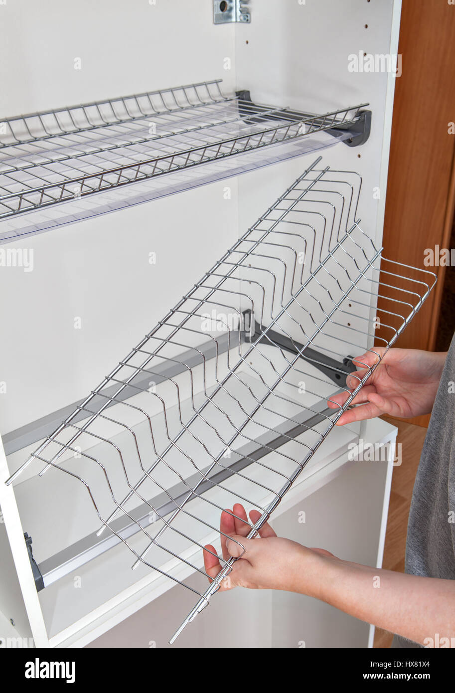 Superieur Install Wall Mounted Shelf Under Kitchen Cabinet With Inside Dish Rack With Drip  Tray, Close Up Of A Woman Hands Holds Wire Part.