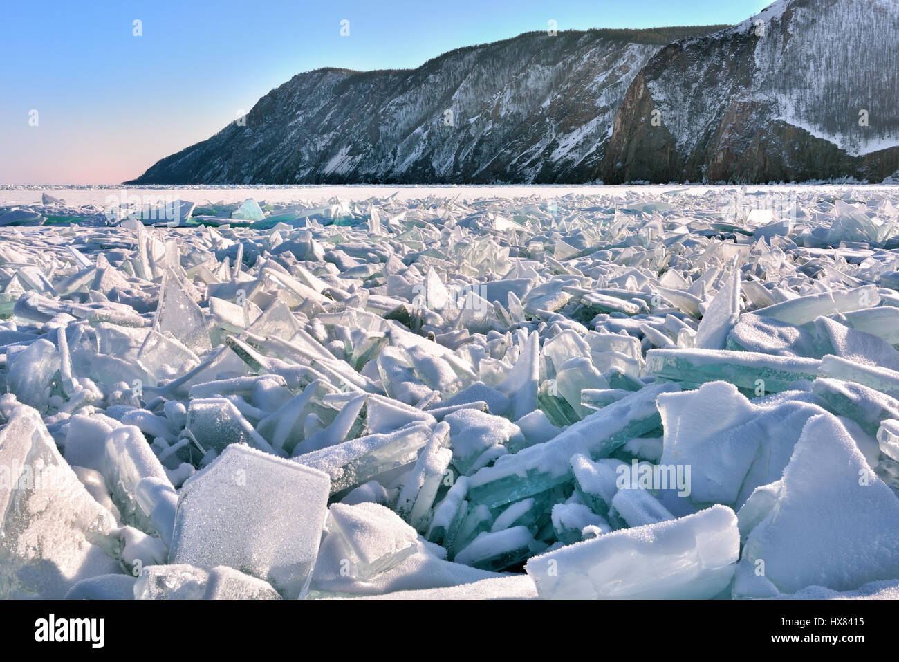 Pile of large fragments of ice. Hummocks occurred as a result of destruction of ice by wind at freeze-up. Lake Baikal. - Stock Image