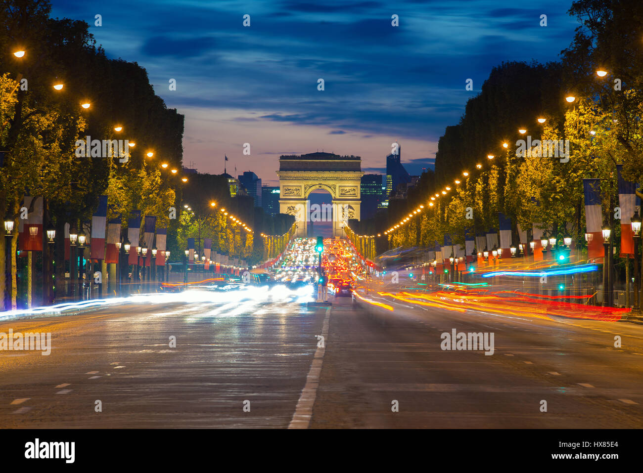 Night view of Paris traffic in Champs-Elysees street and the Arc de Triomphe in Paris, France. - Stock Image