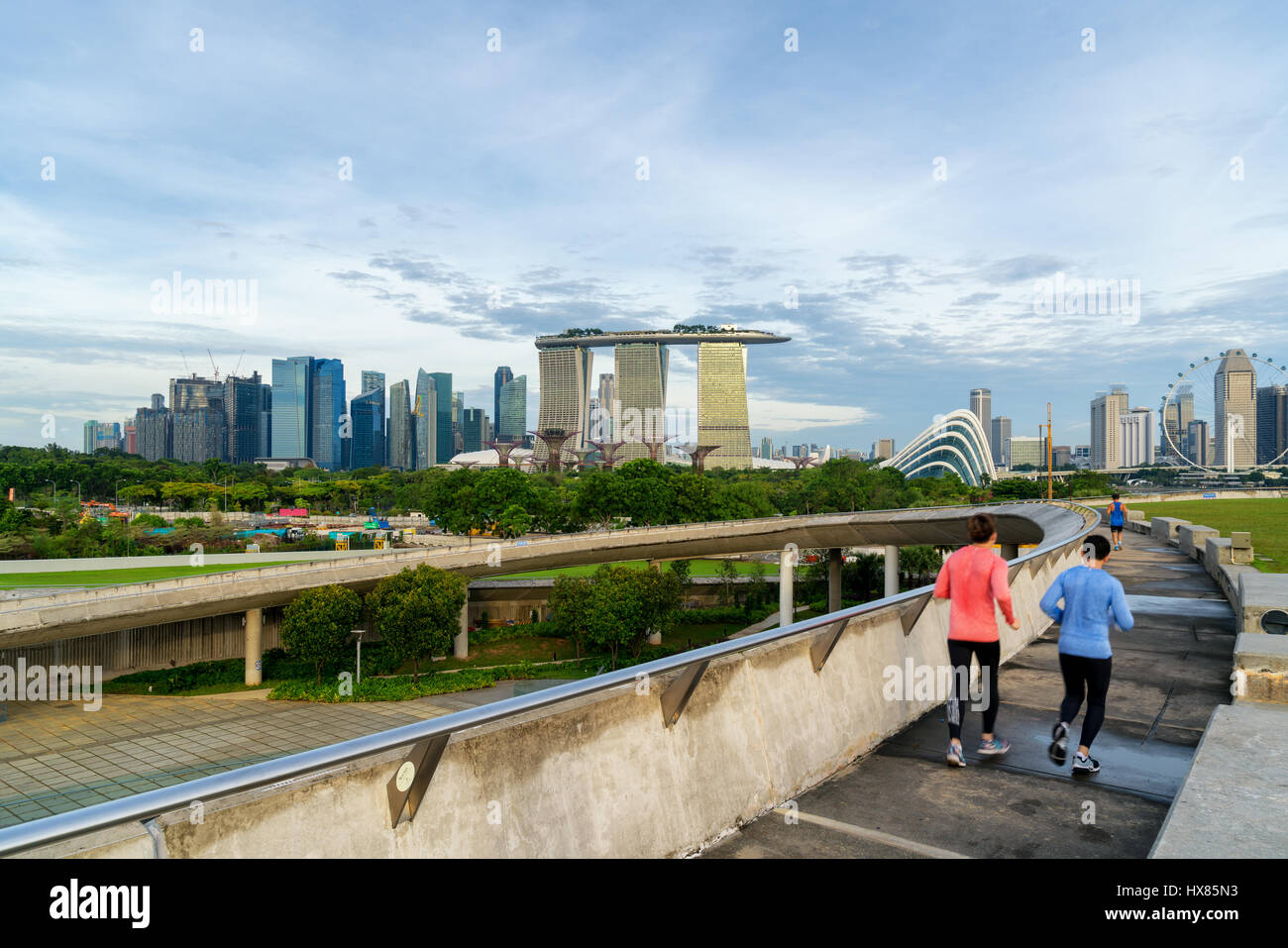 People jogging at morning in Singapore. Singapore Downtown Core in the background. Stock Photo
