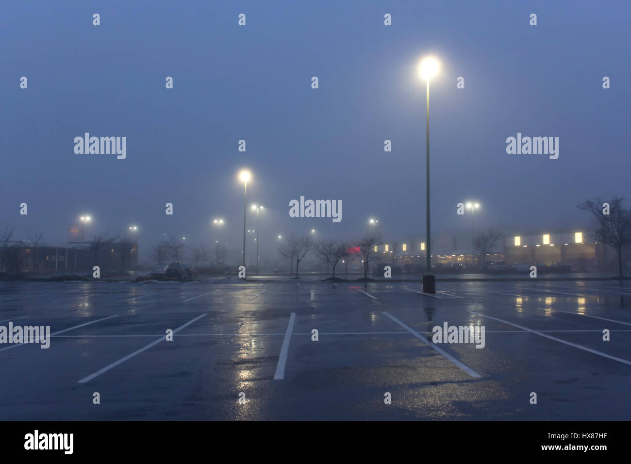 Early morning foggy parking lot Stock Photo