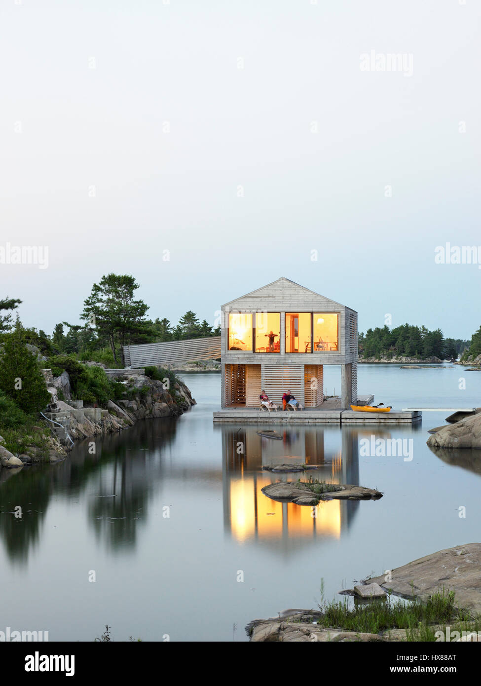 Overall Contextual Exterior View At Dusk. Floating House, Private Island,  Georgian Bay, Lake Huron, Canada. Architect: MOS Architects, 2007 Great Pictures
