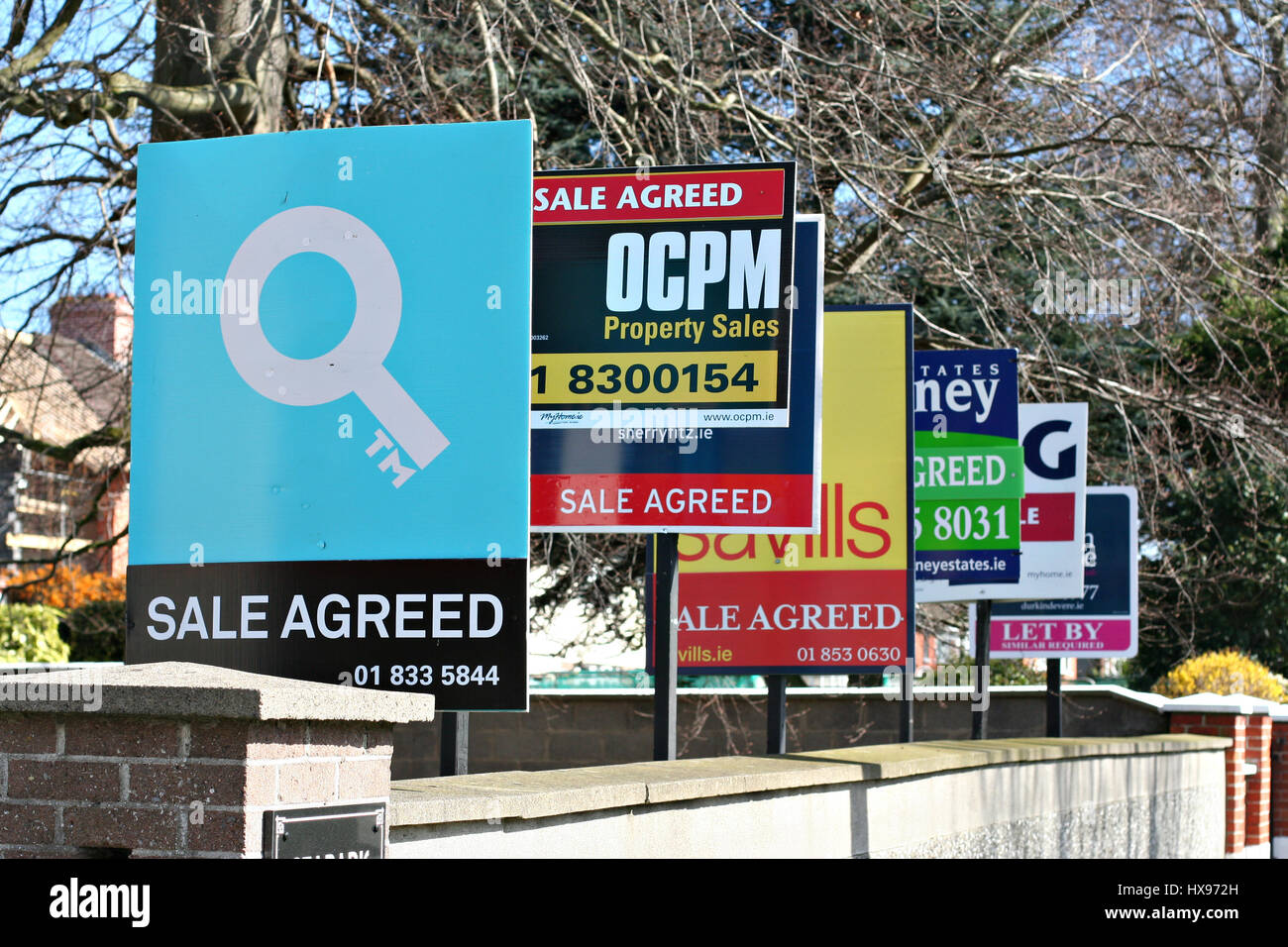 Row for sale signs, let sign from different estate agents erected ...