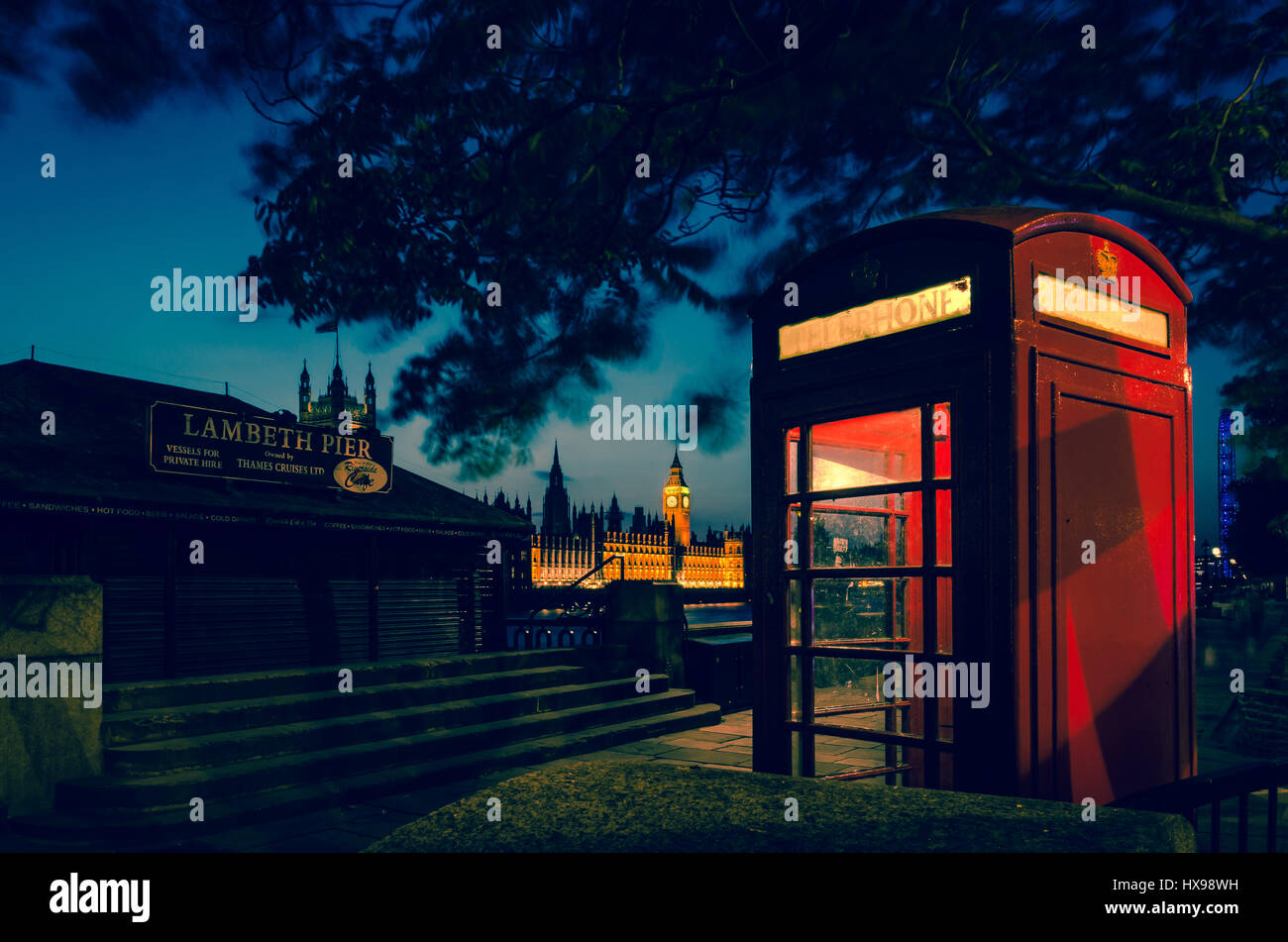 London red telephone box with big ben and westminster in the background taken at twilight Stock Photo