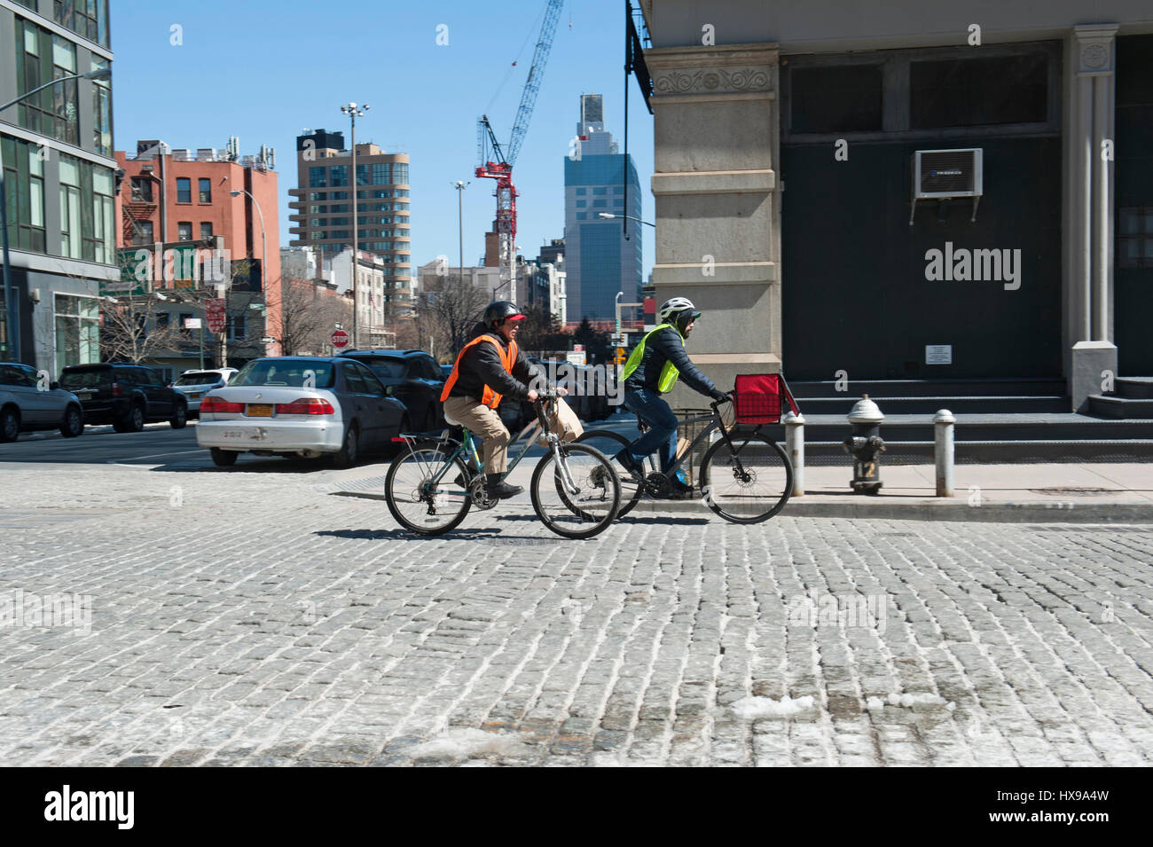 Bicycle messengers pedaled down Greenwich Street in Tribeca, a historic neighborhood in Lower Manhattan. March 23, - Stock Image
