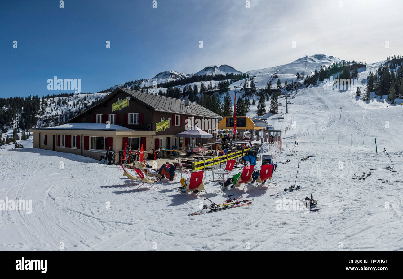 Restaurant Klingenstock in winter, located just next to alpine skiing slopes, for skiers who enjoy a break and outside - Stock Image