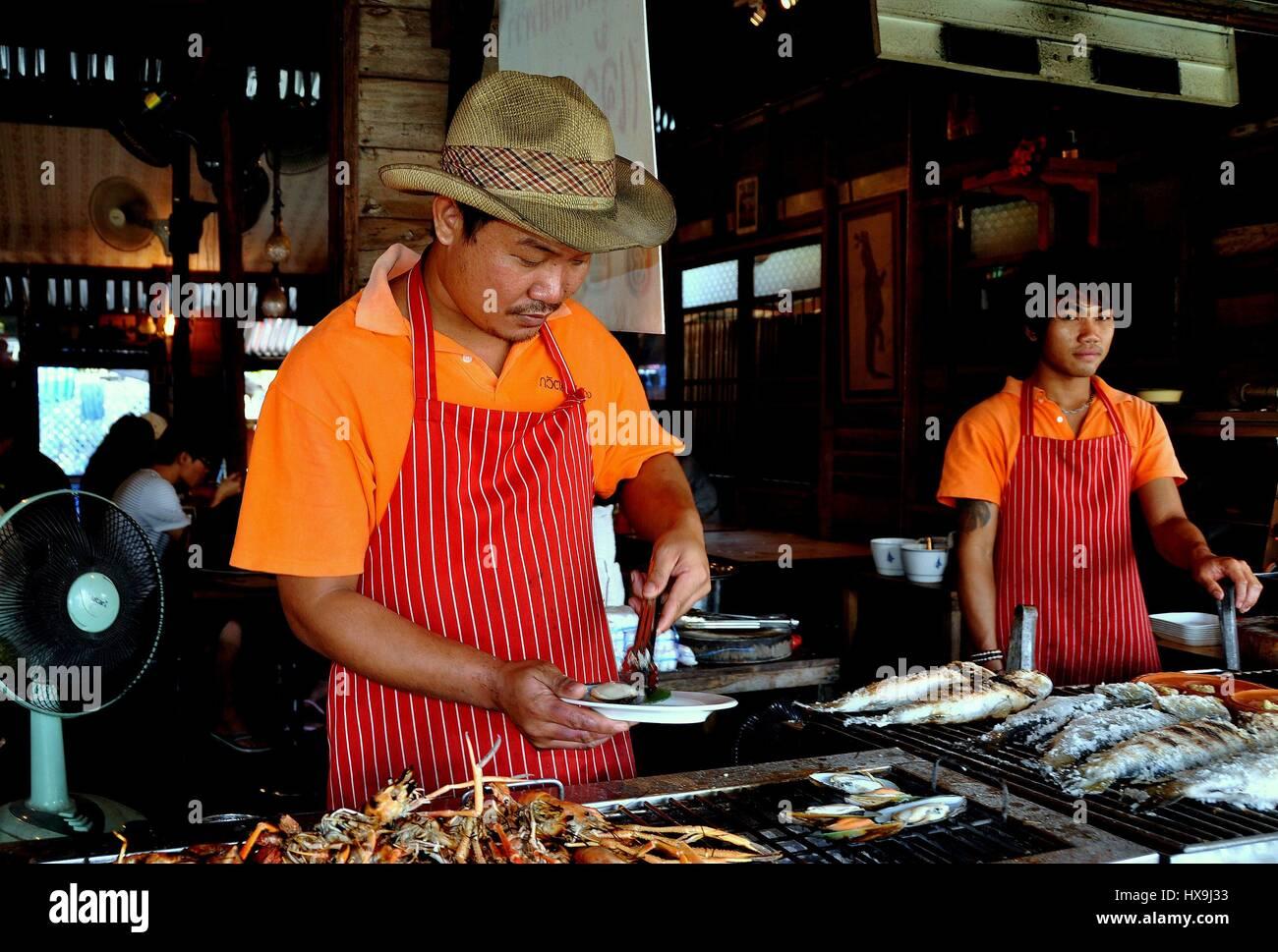 082fb3b98 Amphawa, Thailand - December 17, 2010: Thai chef wearing cowboy hat ...
