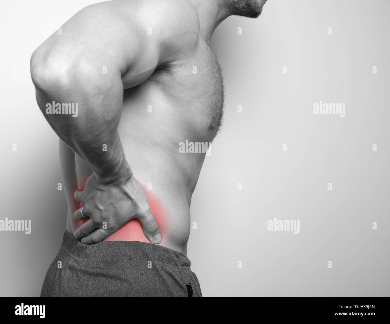 pain in the back of the athlete - Stock Image