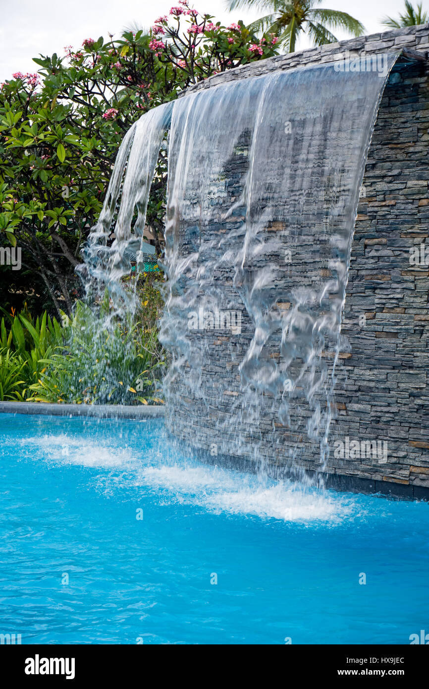 Waterfall in the swimming pool Stock Photo: 136665716 - Alamy