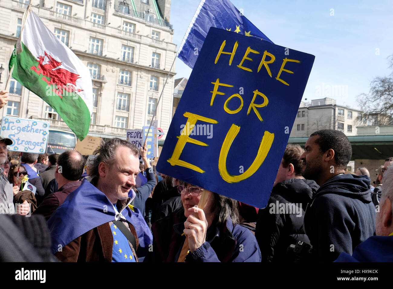 A protester holds a placard reading 'here for Europe' at a march against Brexit in central London. - Stock Image