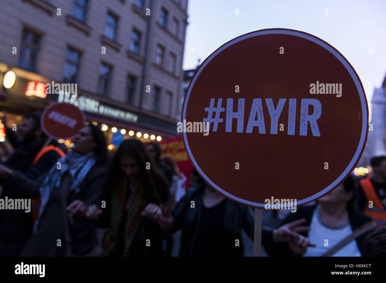 Berlin, Germany. 25th Mar, 2017. Opponents of RECEP TAYYIP ERDOGAN, President of Turkey, holding signs with the inscription '#Hayir'. Several hundred people rally in Berlin Neukoelln and Kreuzberg, the protesters damand a No vote in the constitutional referendum in Turkey, where Turks living in Germany are allowed to vote. Credit: Jan Scheunert/ZUMA Wire/Alamy Live News Stock Photo