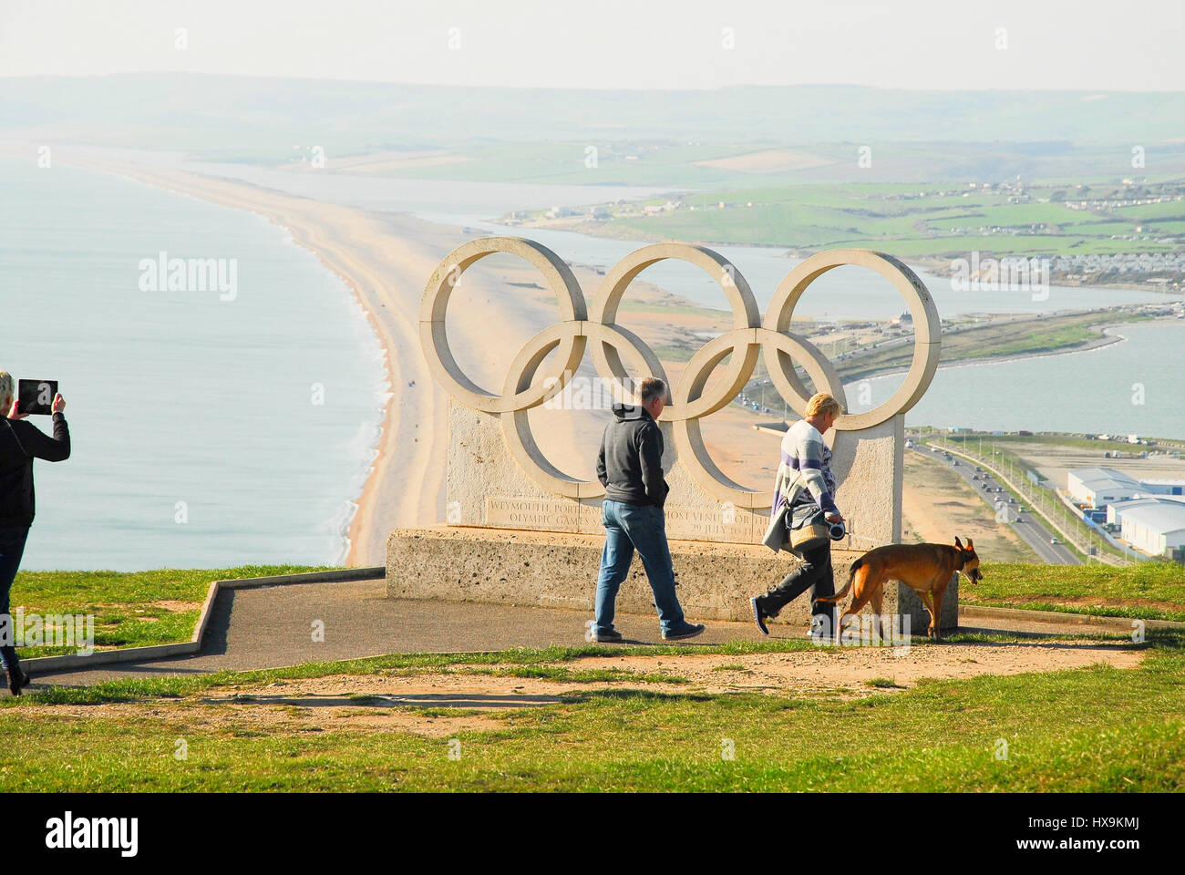 Portland, Dorset, UK. 25th Mar, 2017. People enjoy a very warm day, high above Chesil Beach, on the Isle of Portland. - Stock Image