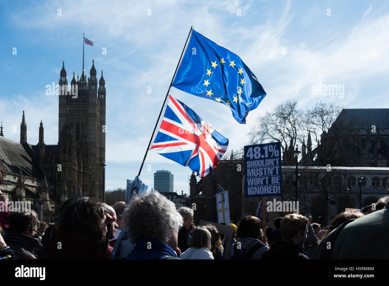 Many people held up European and Union Flags during the United for Europe March in London, UK on the 25th of March - Stock Image