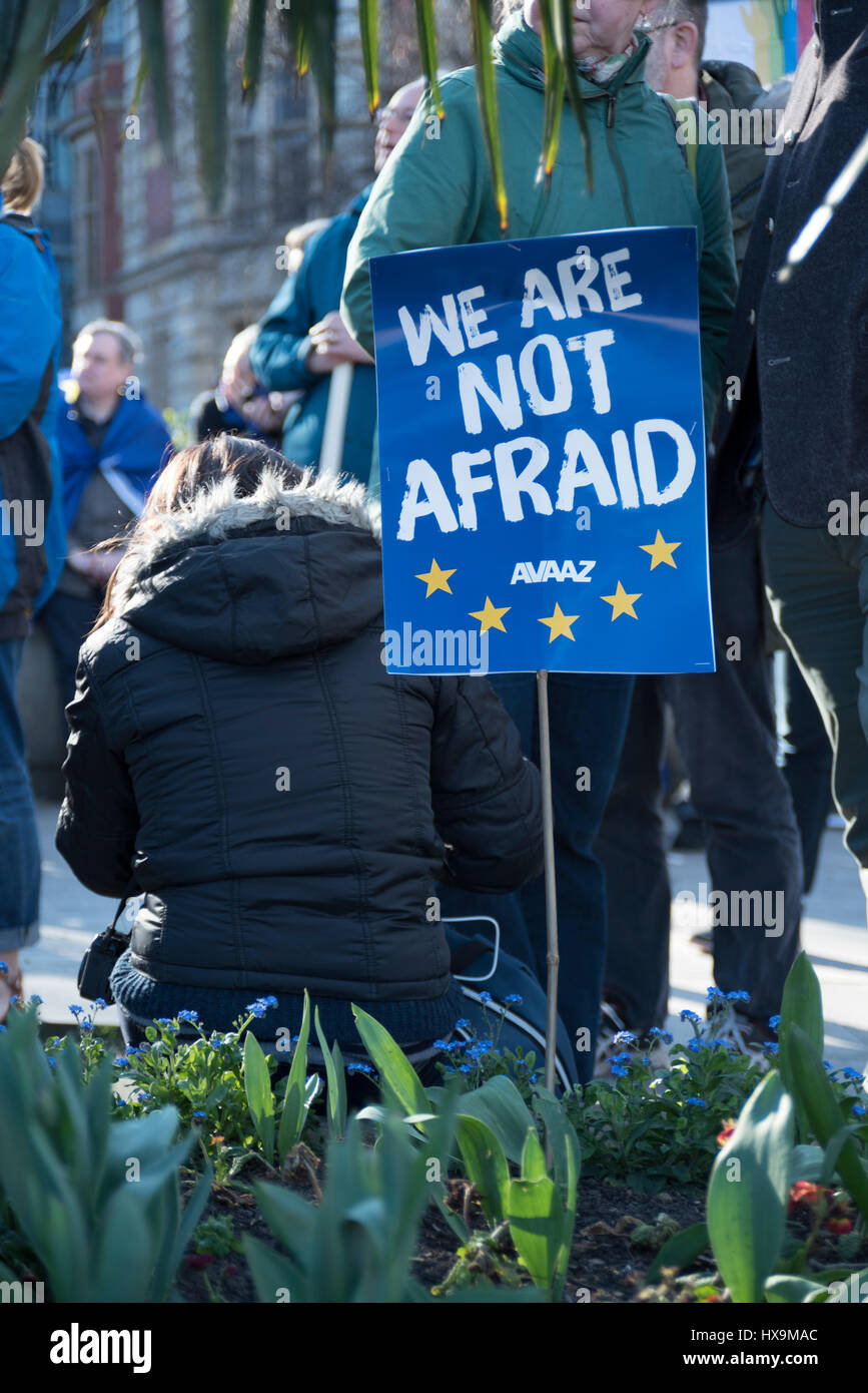 A protestor sitting down with her 'We are not afraid' sign during the United for Europe March in London, - Stock Image