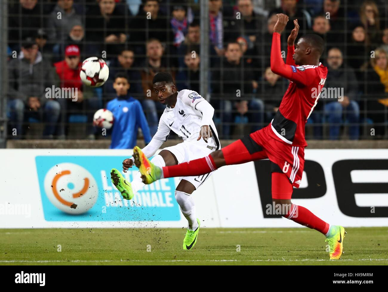Luxembourg. 25th Mar, 2017. Ousmane Dembele (L) of France passes the ball during the FIFA World Cup 2018 qualifying - Stock Image