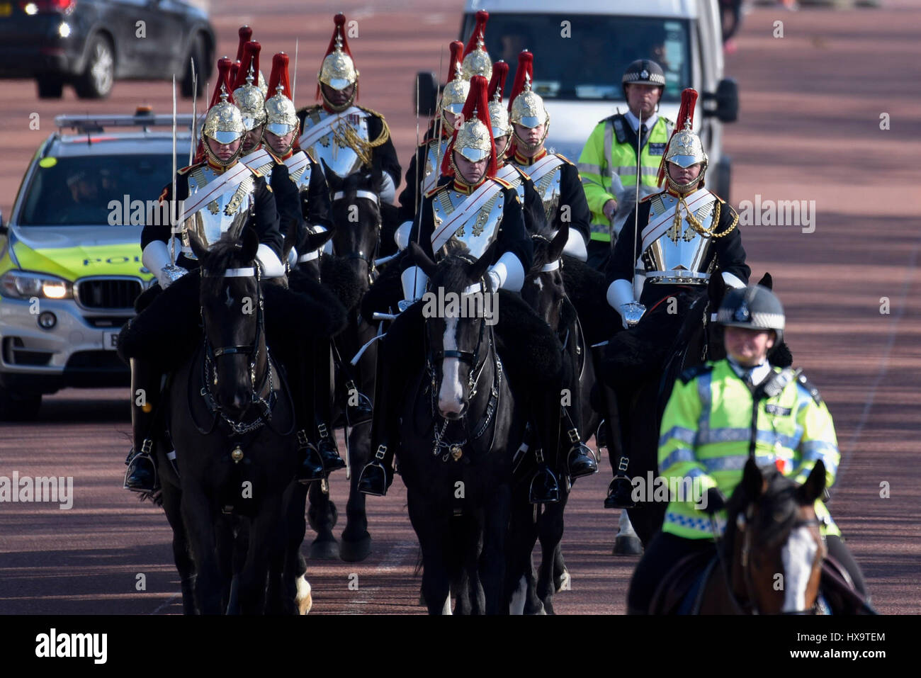 London, UK.  26 March 2017.  The Household Cavalry wearing their silver cuirasses take part in The Changing the - Stock Image