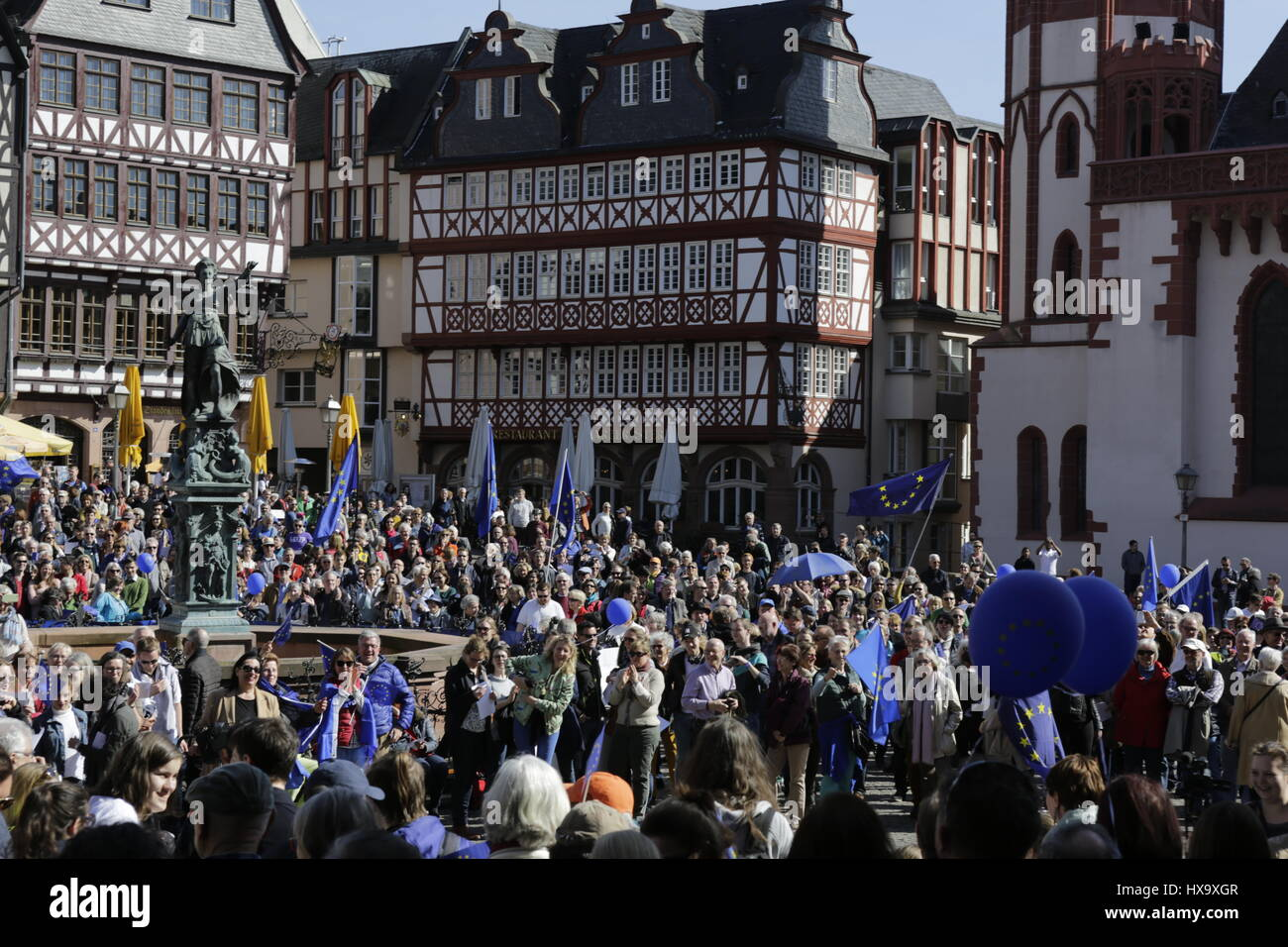 Frankfurt, Germany. 26th Mar, 2017. People have assembled outside of Frankfurt City Hall with European Union flags - Stock Image