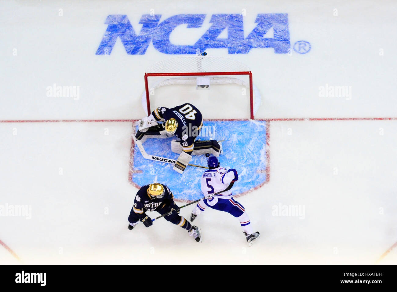 Sunday, March 26, 2017: Notre Dame Fighting Irish goalie Cal Petersen (40) stops a shot by Massachusetts-Lowell - Stock Image