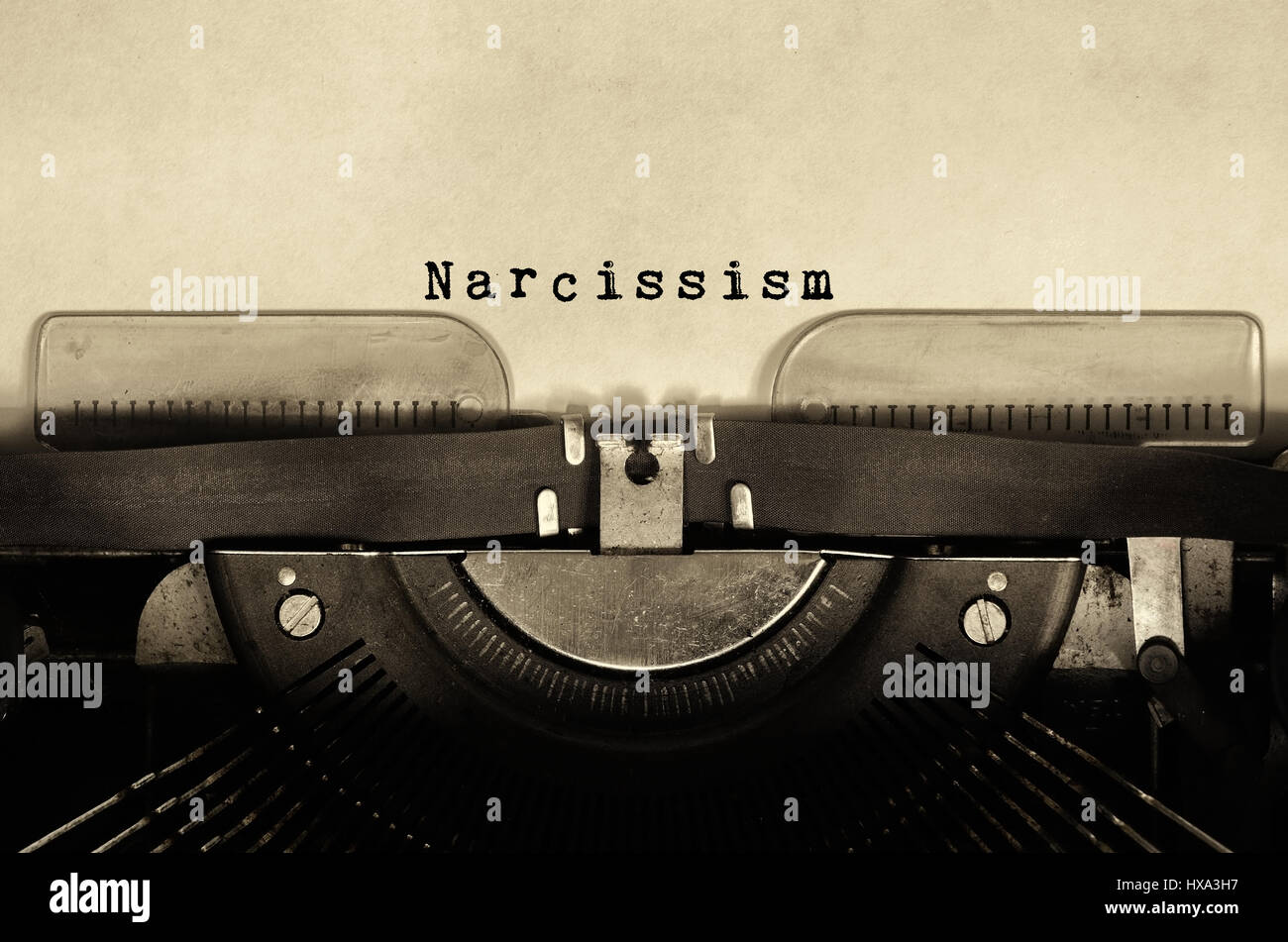 Narcissism word typed on vintage typewriter - Stock Image