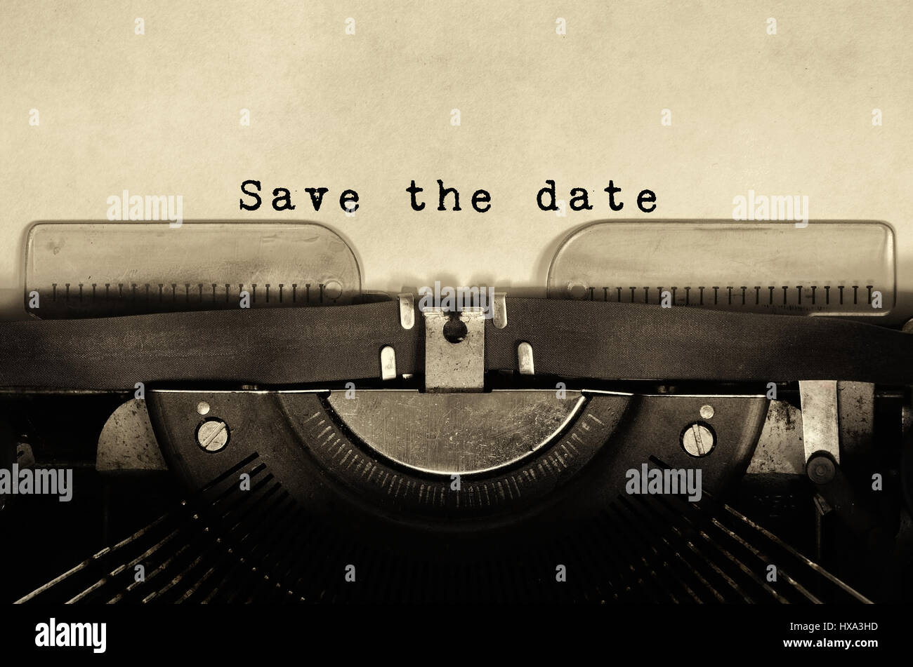 Save the date words typed on vintage typewriter. - Stock Image