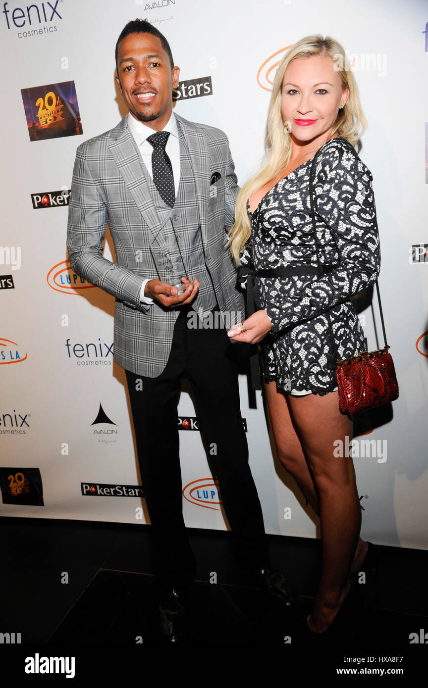 TV personality Nick Cannon (L) and Nicole Paxson attend the Stars Get Lucky For Lupus: 6th Annual Poker Tournament - Stock Image