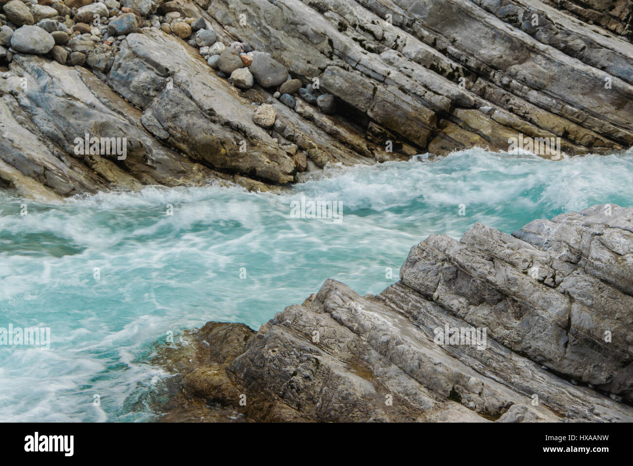Very particular river rocks carved by turques water, in the mountain - Stock Image