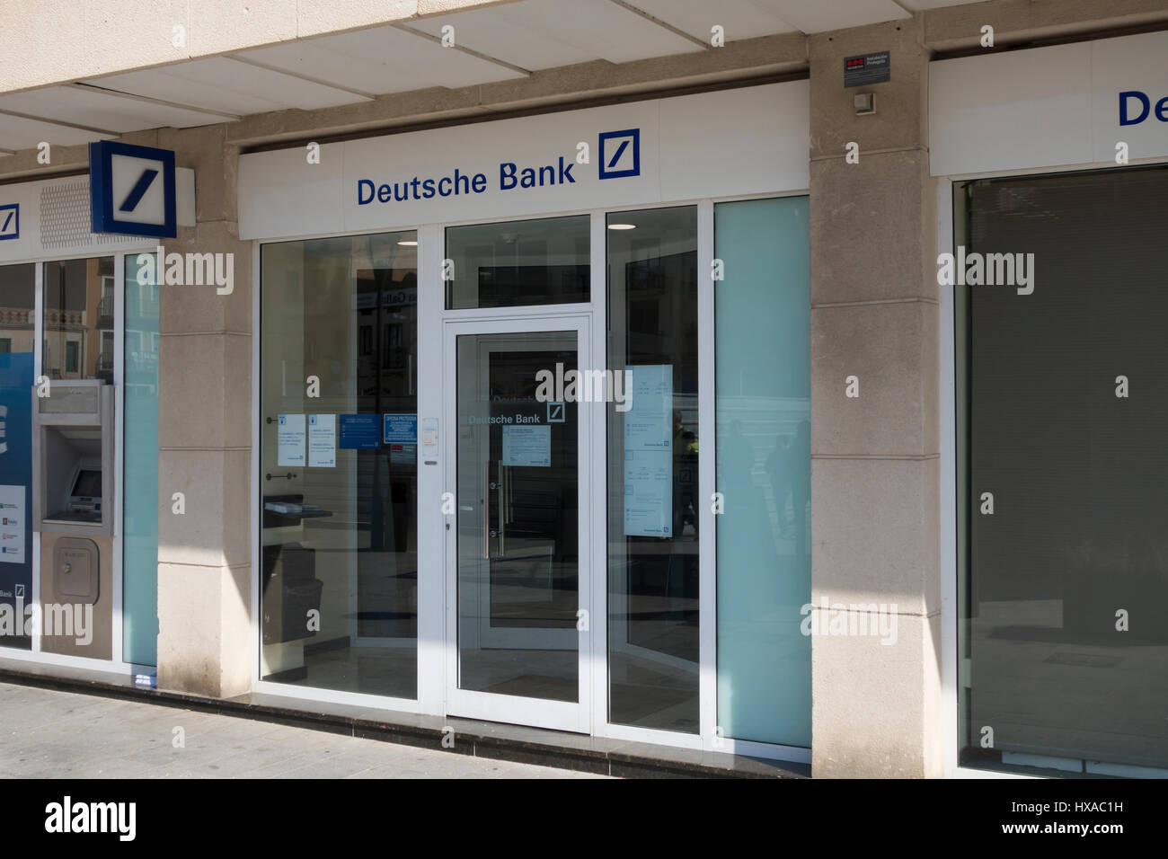Deutsche Bank branch office outdoor, with blue text and logo in a billboard, in the city of Cambrils at Spain - Stock Image