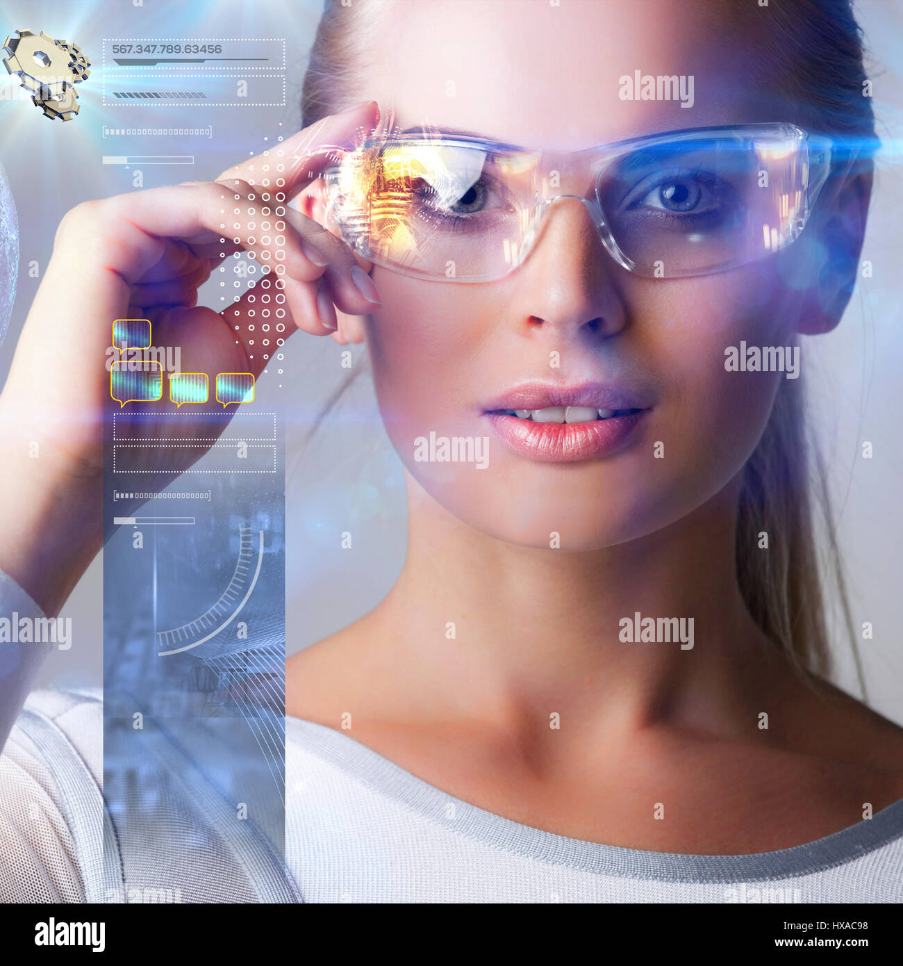 Woman in futuristic glasses work with abstract holografic data - Stock Image