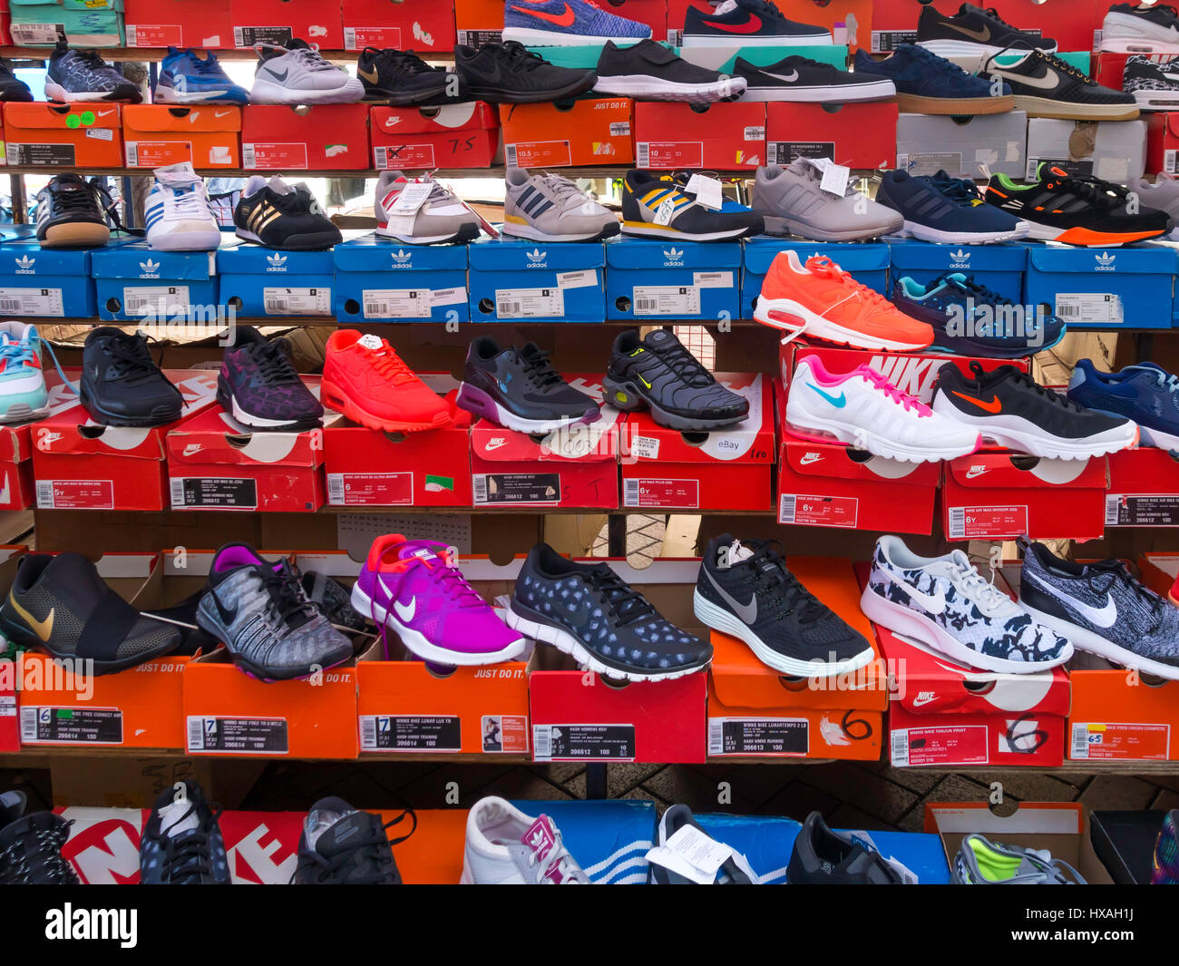 41a36e8dde3 A display of Nike brand trainers for sale on a street market stall ...