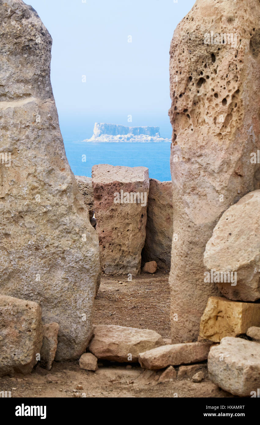 The view of Filfla islet through the foramen of two Orthostats of megalithic temple of Hagar Qim, Malta Stock Photo