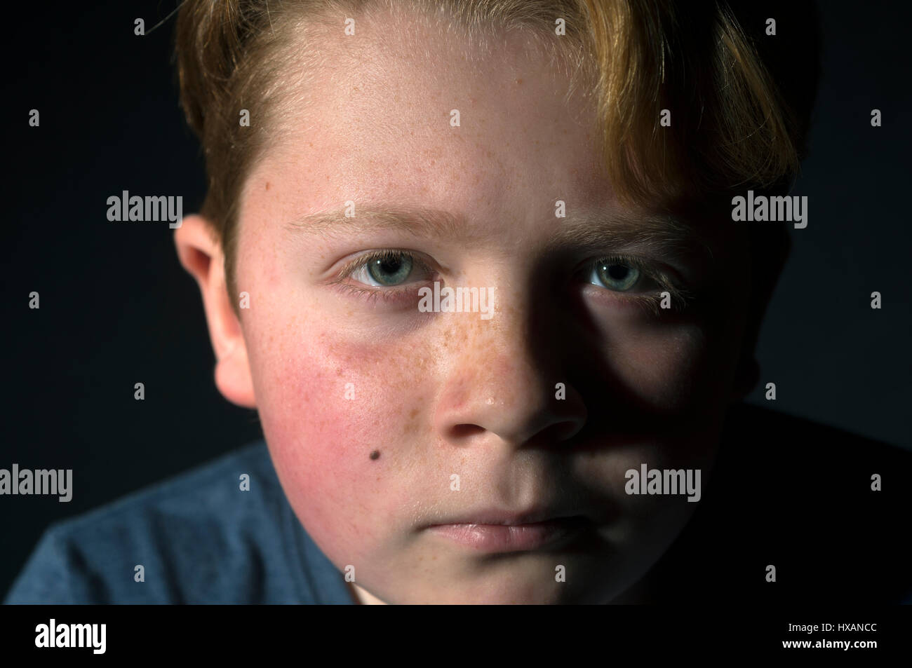Ginger haired boy - Stock Image