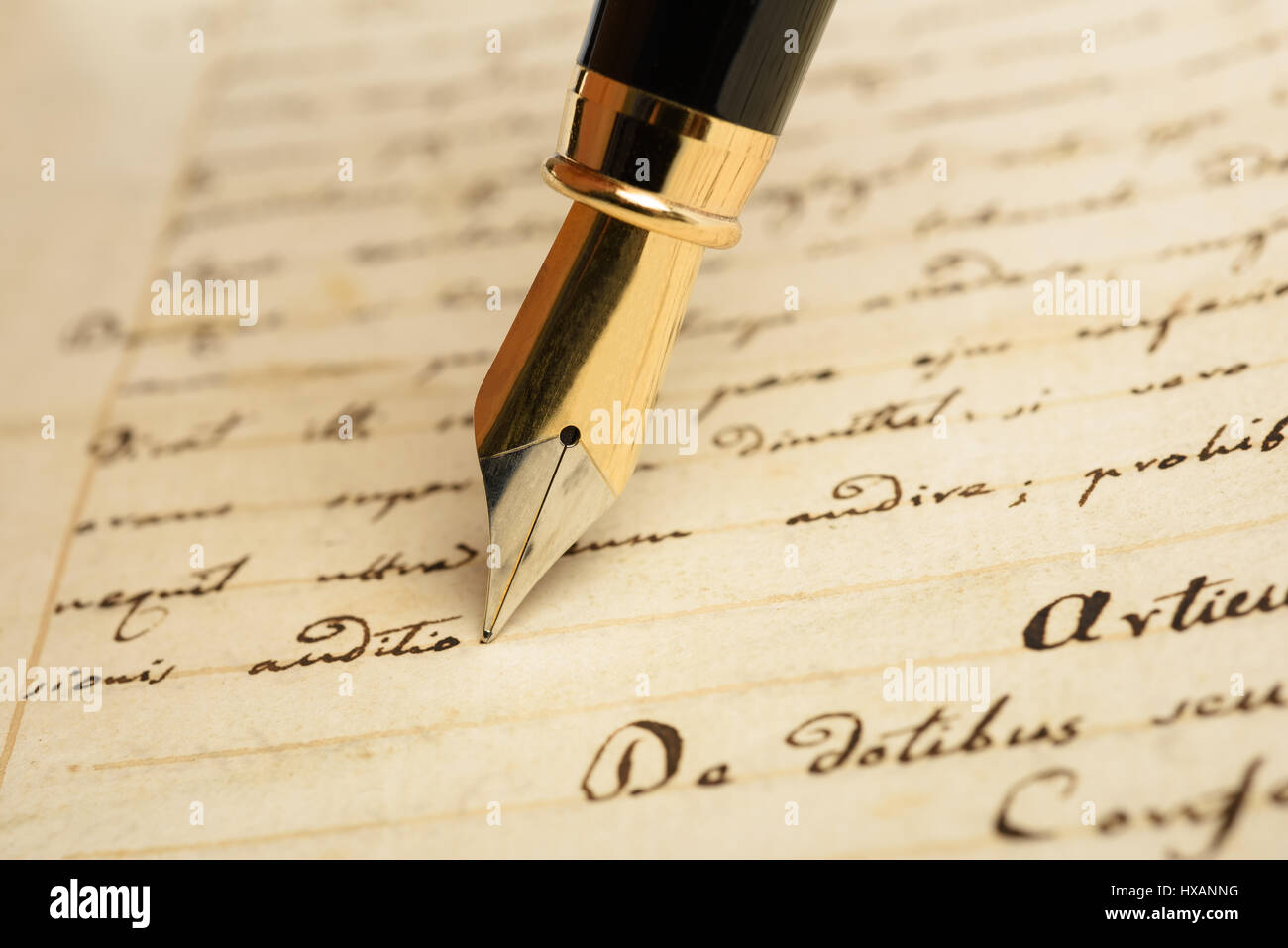 Fountain pen is writing on a letter - Stock Image