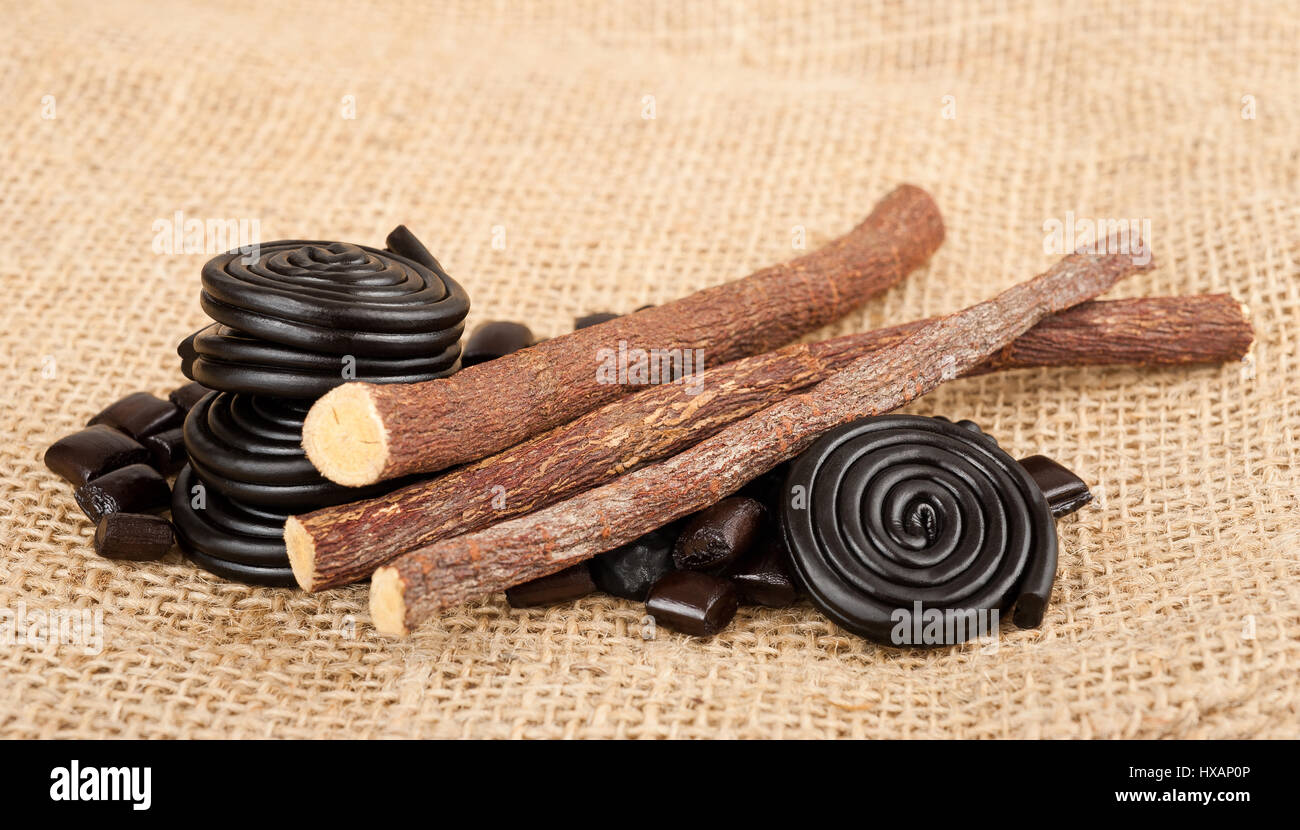 licorice candy and licorice  wheels isolated on white - Stock Image