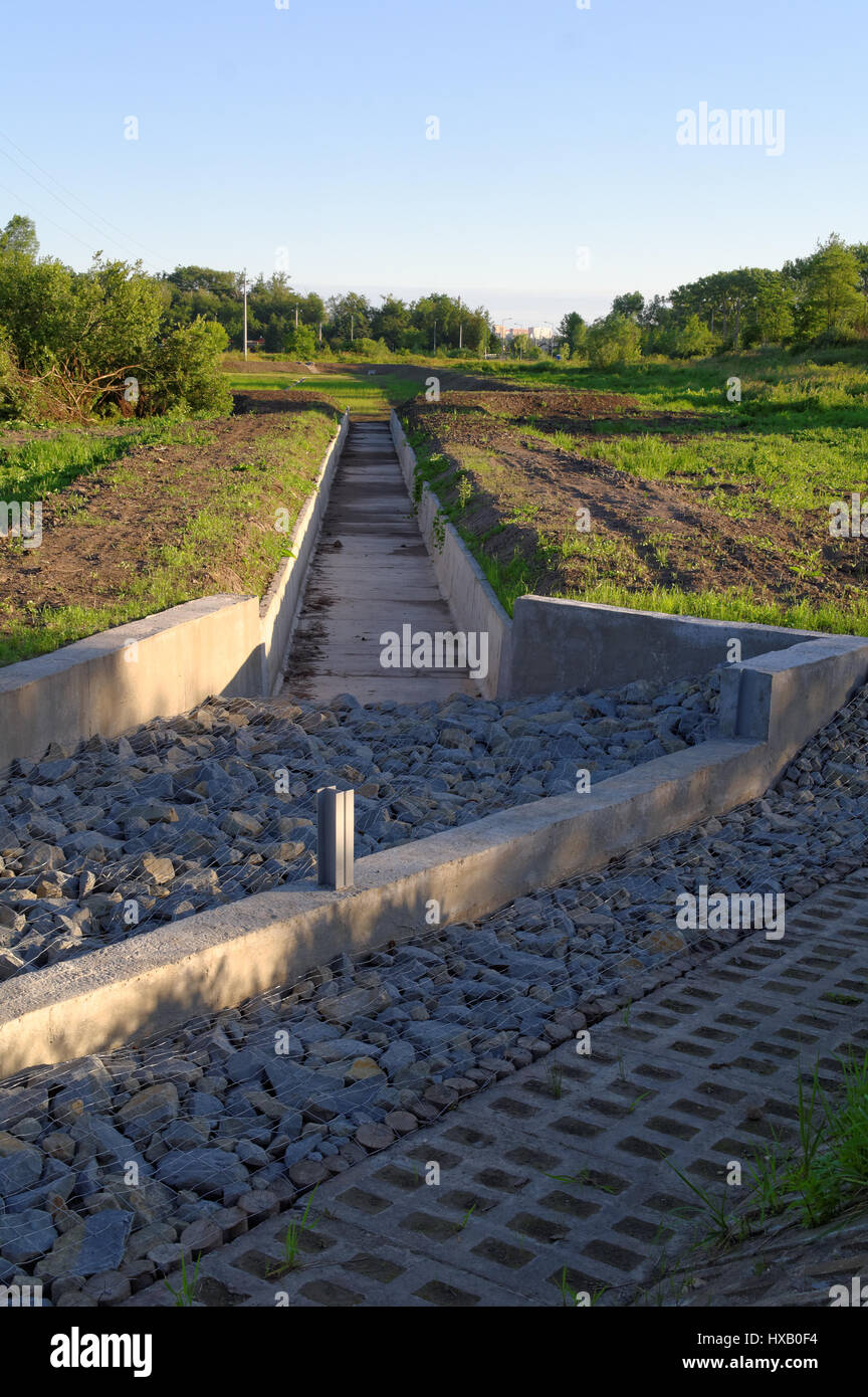 retention tank outside the city under construction - Stock Image