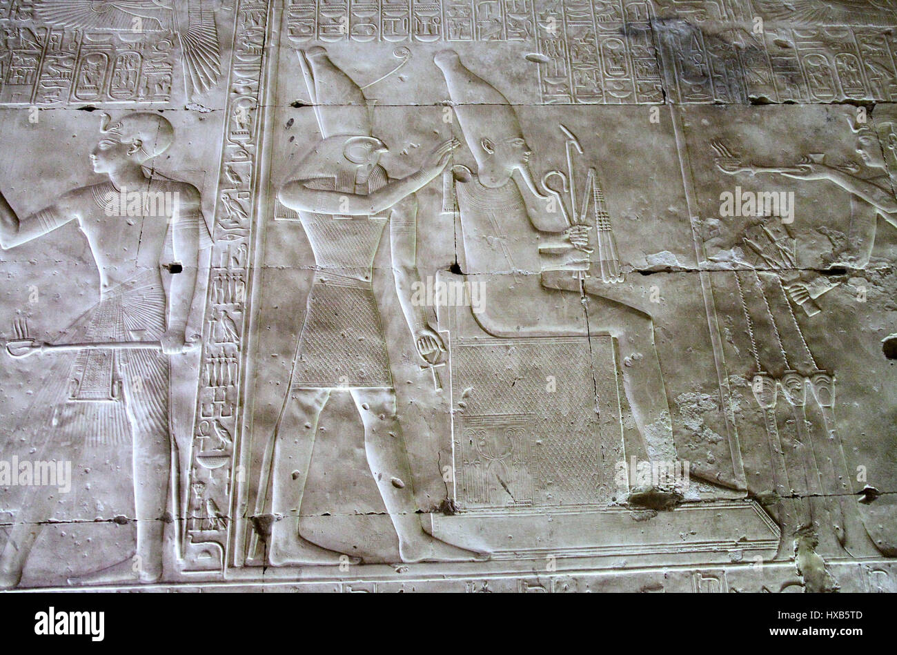 Pharaoh Seti l holds out a censer to Osiris at Abydos Temple - Stock Image