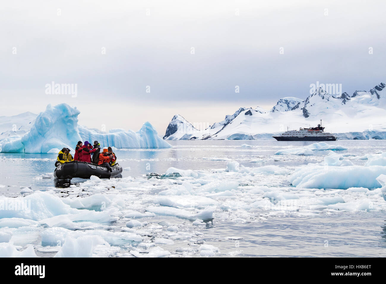 Antarctica tourists in Zodiac among Antarctic iceberg. - Stock Image