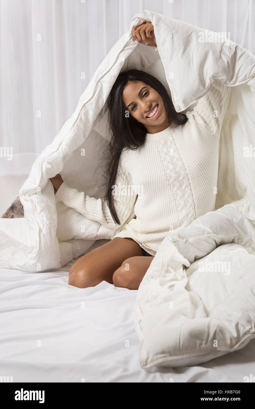 Young woman at home in bedroom Stock Photo