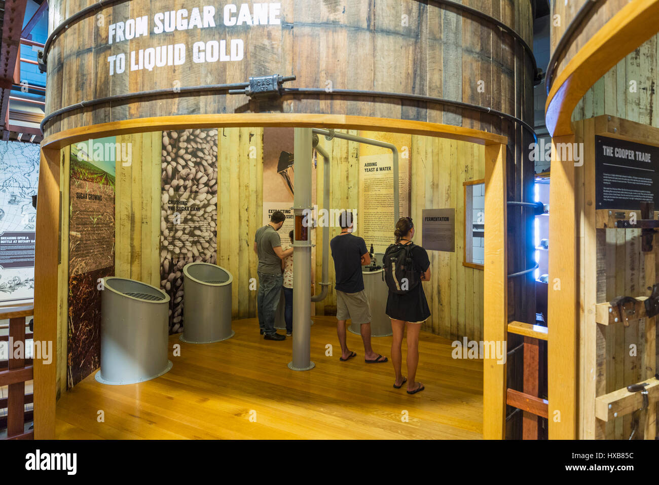 Visitors learning about the history of Bundaberg Rum in the Museum Experience.  Bundaberg, Queensland, Australia - Stock Image