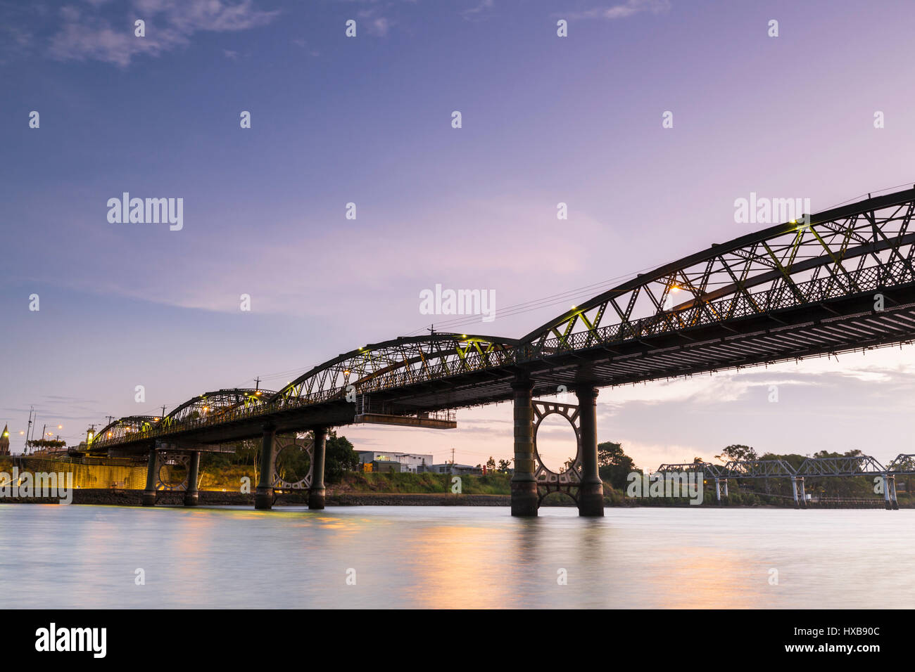 The heritage-listed Burnett Bridge at twilight.  Bundaberg, Queensland, Australia - Stock Image
